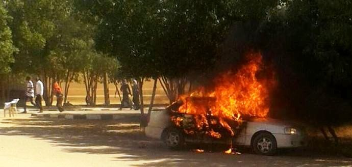 A car on fire near the University of Bahri on Monday, 22 December 2014 (RD)