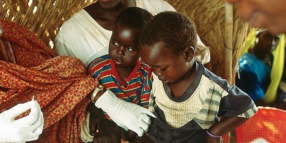 A medic treats a child in a health centre in Darfur (file photo)