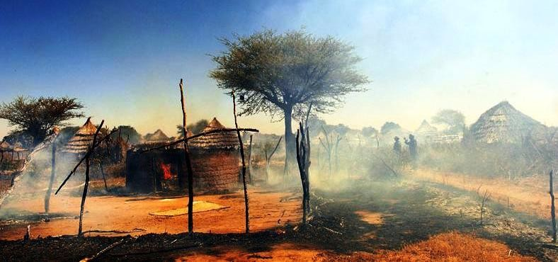 African Union soldiers in a burnt village in Darfur (file photo)