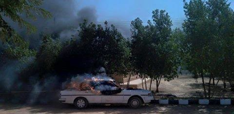 A car on fire at the Kadaro compound of Bahri University, 22 December 2014 (RD)
