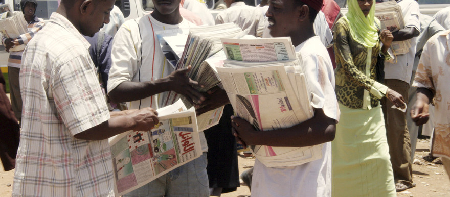 Sudanese newspaper vendors talk to each other at a bus station in Khartoum, 2007 (file photo)