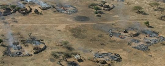 A burning village in Darfur (Brian Steidle)
