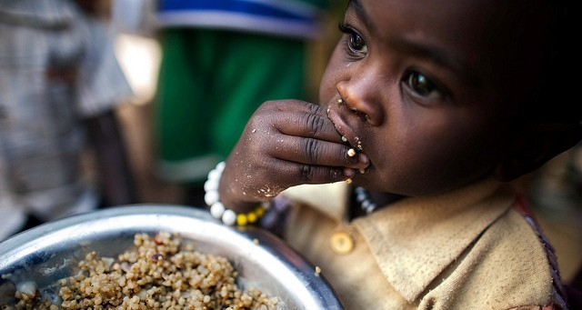 A child eats lentils in a food distribution centre in the Rwanda camp in Tawila locality, North Darfur, 4 March 2014 (Albert González Farran/Unamid)