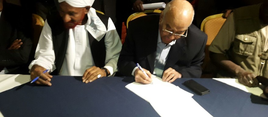 At the signing of the Sudan Appeal: El Sadig El Mahdi (NUP) and Dr Amin Mekki Madani (file photo)