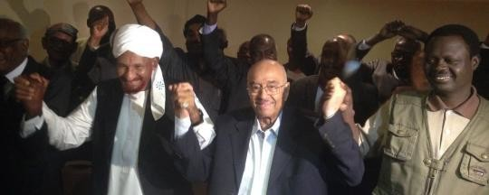 El Sadig El Mahdi (L), Dr Amin Mekki Madani (C), and Minni Minawi (R), after the signing of the Sudan Appeal, 3 December 2014 (SRF)