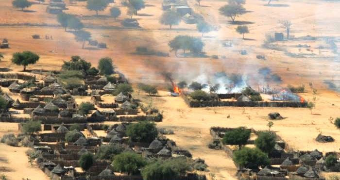 Burning house in Darfur (file photo)