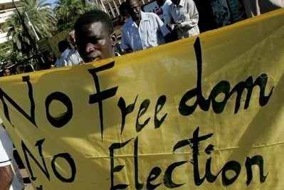 A protester in Khartoum before the 2010 general elections (file photo)