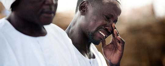 Crying displaced in Darfur (file photo)