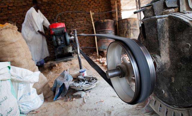 A miller starts the engine of his automatic mill to obtain flour from grain in El Mawashi market in El Fasher, North Darfur (Albert González Farran/Unamid)