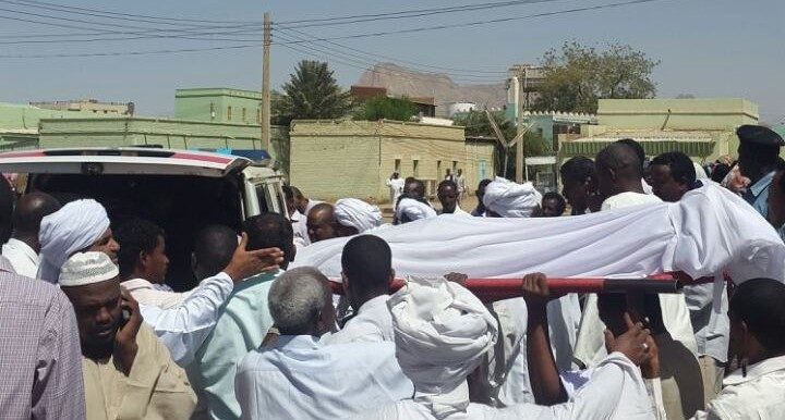 The body of Samia Mohamed Bushra being taken from the hospital, 24 February 2015 (Dabanga)