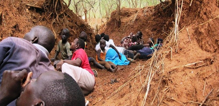 Civilians hide from airplane bomb attacks in the Nuba Mountains in 2011 (file photo)