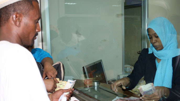 A man is changing money at an Forex office in Khartoum (file photo)