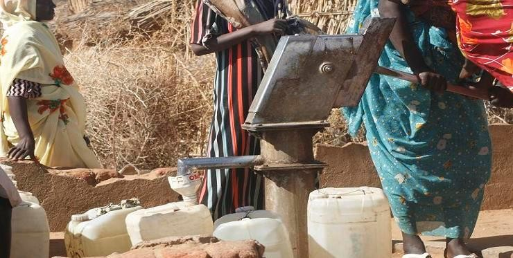 Women collect water from a well in  Darfur (file photo)