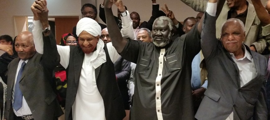 Opposition leaders cheer after signing the position paper in Berlin, 27 February 2015