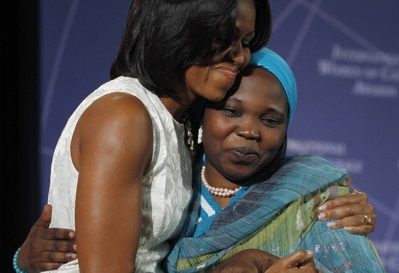 US first lady Michelle Obama congratulates Hawa Abdallah Mohamed Salih with the International Women of Courage Award in 2012