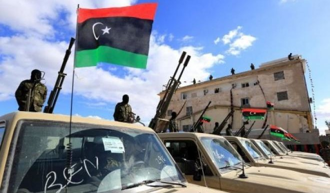Libyan security forces attend the graduation ceremony of a new batch of border guards (Mahmud Turkia/AFP)