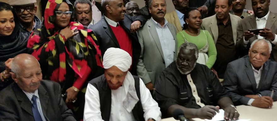 Opposition members cheer after the signing of the Berlin Declaration, 27 February 2015 (Radio Dabanga)
