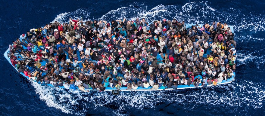 African asylum seekers packed into a boat (The Guardian)