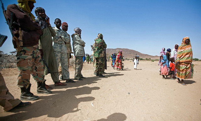 Militiamen 'standing guard' near a camp for the displaced in Darfur (file photo)