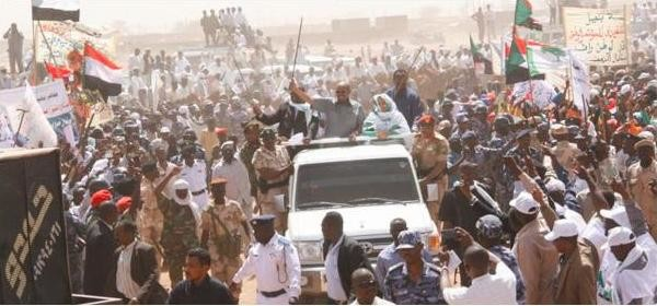 President Omar Al Bashir parades through Nyala, South Darfur, as part of his electoral campaign, 19 March 2015 (Sudan Vision Daily).