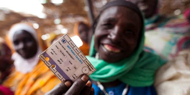 A displaced woman shows her food ration card, given by the UN World Food Programme to the Kassab camp residents in North Darfur in 2012 (Albert González Farran/Unamid)