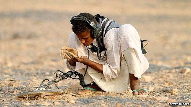 A man with a gold detector in Sudan (Getty)