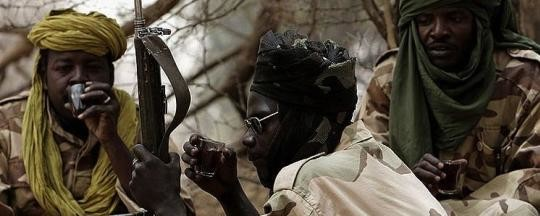 JEM fighters drinking tea in Darfur (Stuart Price/Albany Associates)
