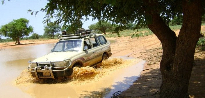 In Darfur, four-wheel-drive vehicles are the only practical way of getting around during the rainy season (File photo)