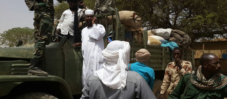 Militiamen speaking to locals in Darfur (RD)