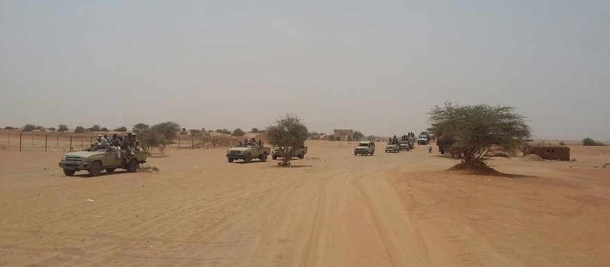 One year after their first deployment in Darfur, the paramilitary Rapid Support Forces (RSF) drive in armoured vehicles in East Jebel Marra in January 2015 to fight against armed movements (SAF)