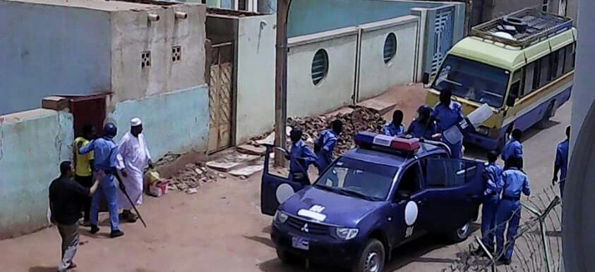 Police forces detain people in El Gereif East, Khartoum, on Friday 12 June.