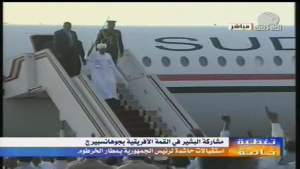 Bashir steps out of the plane returning from South Africa on 15 June (Ashorooq TV)