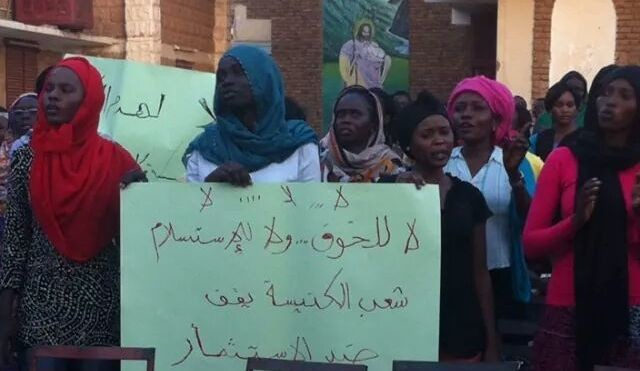 Women protest at the Evangelical church in Khartoum North against the confiscation of the church premises, 19 September 2014 (file photo)