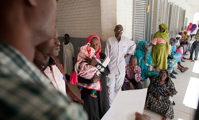 A medical staff member controls the access of the Emergency Room in El Fasher Hospital (Unamid)