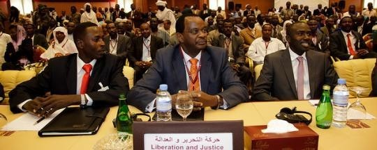 Dr El Tijani Sese, head of the Darfur Regional Authority (C), at a political meeting (file photo)