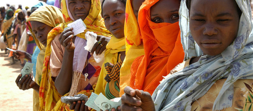 Internally displaced women hold their ration tickets while waiting for a World Food Programme distribution in Mastura, West Darfur, Sudan (Helen Caux/UNHCR)