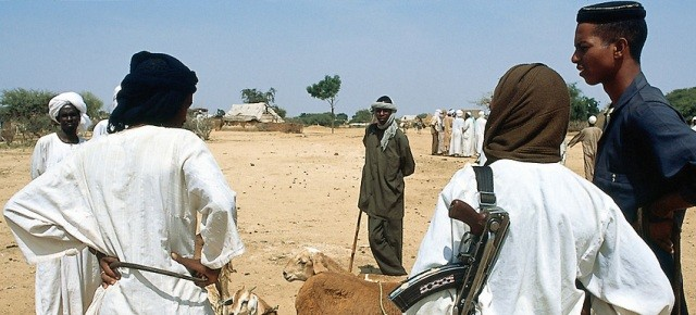 Men carrying weapons in Darfur (file photo)