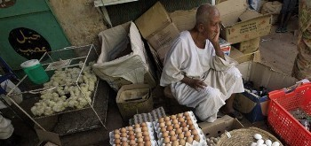 An eggs vendor waits for customers at a market in Khartoum (Mohamed Nureldin Abdallah/Reuters)