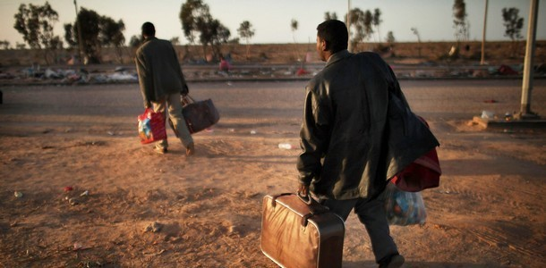 Sudanese migrants who have crossed the border into Libya (file photo)