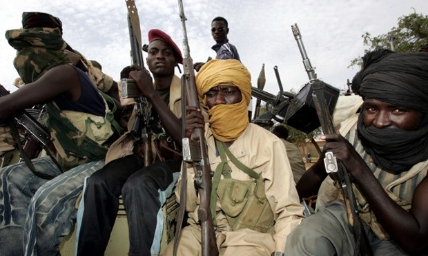 Rebels loyal to Minni Minawi ride into El Fasher, the administrative capital of North Darfur (Ashraf Shazly/AFP)