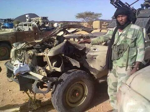 A Sudanese PDF militiaman stands near a damaged vehicle seized from SLM-AW rebels in eastern Jebel Marra on 1 January 2015 (Sudan Armed Forces)