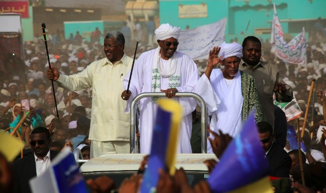 Al Bashir in an earlier mass rally in South Darfur (Ashraf Shazly/AFP)