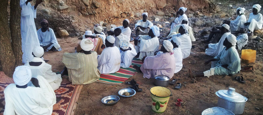Men in Leeba, East Jebel Marra, gathered to pray and read the Koran, in 2015 (RD)