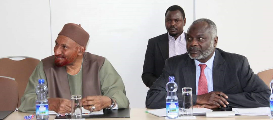 During the consultative meeting in Addis Ababa on 22 March, where the peace roadmap was first proposed to the delegations, El Sadig El Mahdi (NUP, left) and Jibril Ibrahim (JEM) listen to participants (RD)