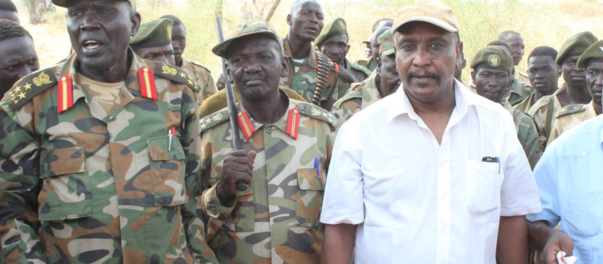 Yasir Arman, Secretary-General of the Sudan People's Liberation Movement-North (in white shirt) with Commanders of the Sudan People's Liberation Army on a recent visit to the Nuba Mountains (RD)