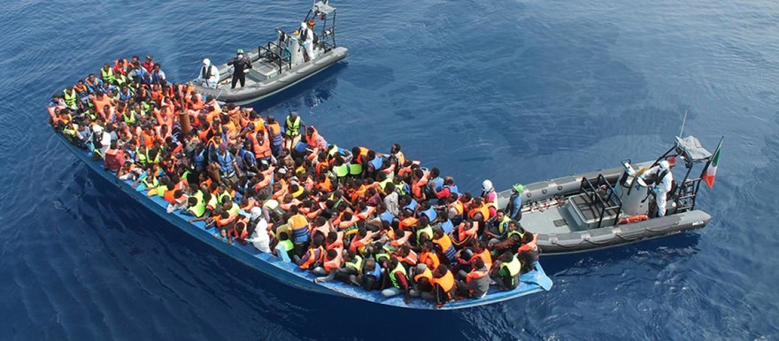 Zodiacs from the Irish Navy ship Le Eithne come to the rescue of a boat in the Mediterranean sea dangerously overloaded with migrants desperate to reach Europe from Africa (Irish Defence Forces)
