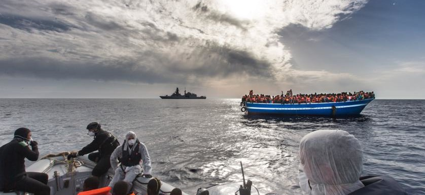 The Italian Navy helps a boatload of people trying to reach Europe from North Africa. Hundreds have died trying to reach Europe. (Italian Navy/M.Sestini)