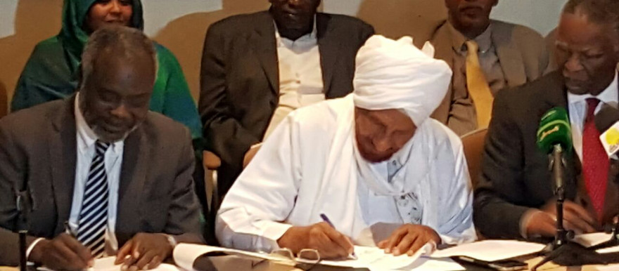 The leader of Sudan's Justice and Equality Movement (JEM), Dr Jibril Ibrahim and National Umma Party (NUP) leader El Sadig El Mahdi sign the roadmap, as AUHIP chief mediator Thabo Mbeki looks on