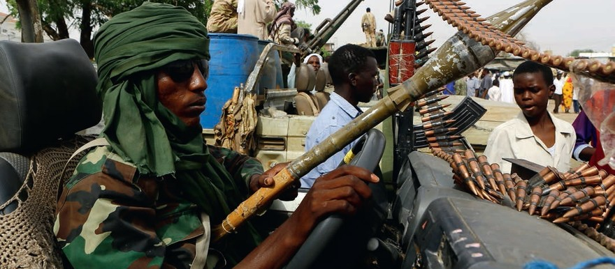 A RSF fighter participates in the display of weapons and vehicles allegedly captured from rebels in South Darfur (Ashraf Shazly-AFP)