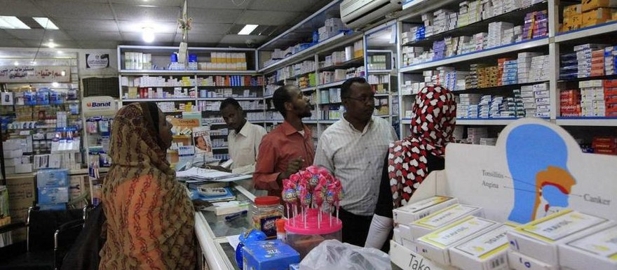 A customer buys medication at a pharmacy in Khartoum, January 2013 (The Globe and Mail)